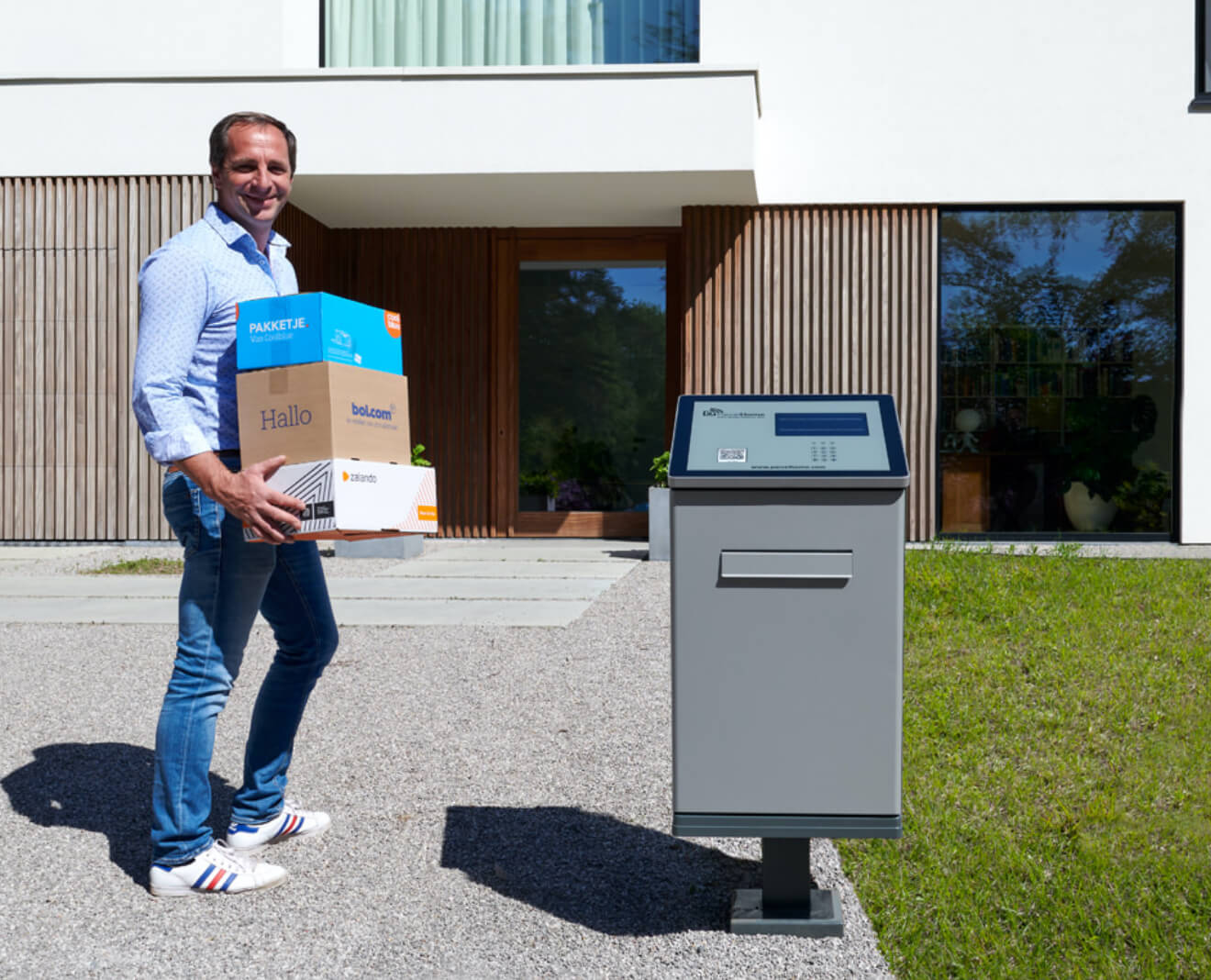 A customer takes his parcels out of his smart letterbox