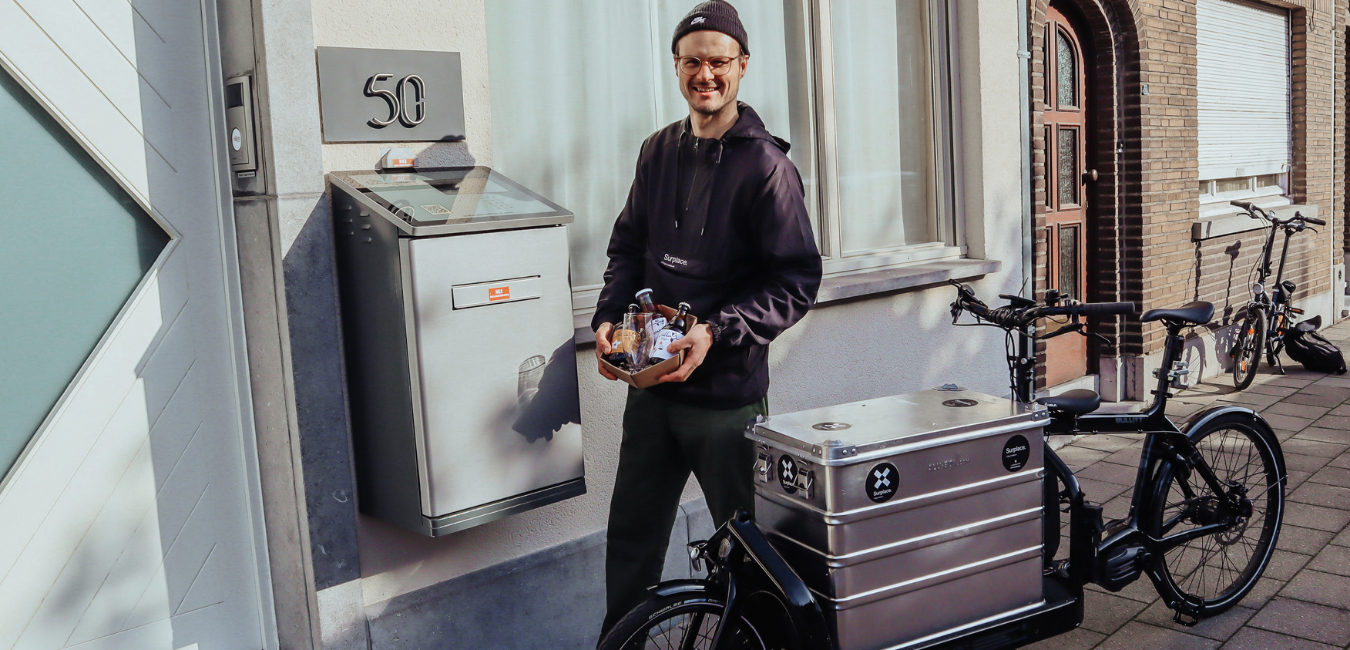 Cycling courier delivers local products in a ParcelHome