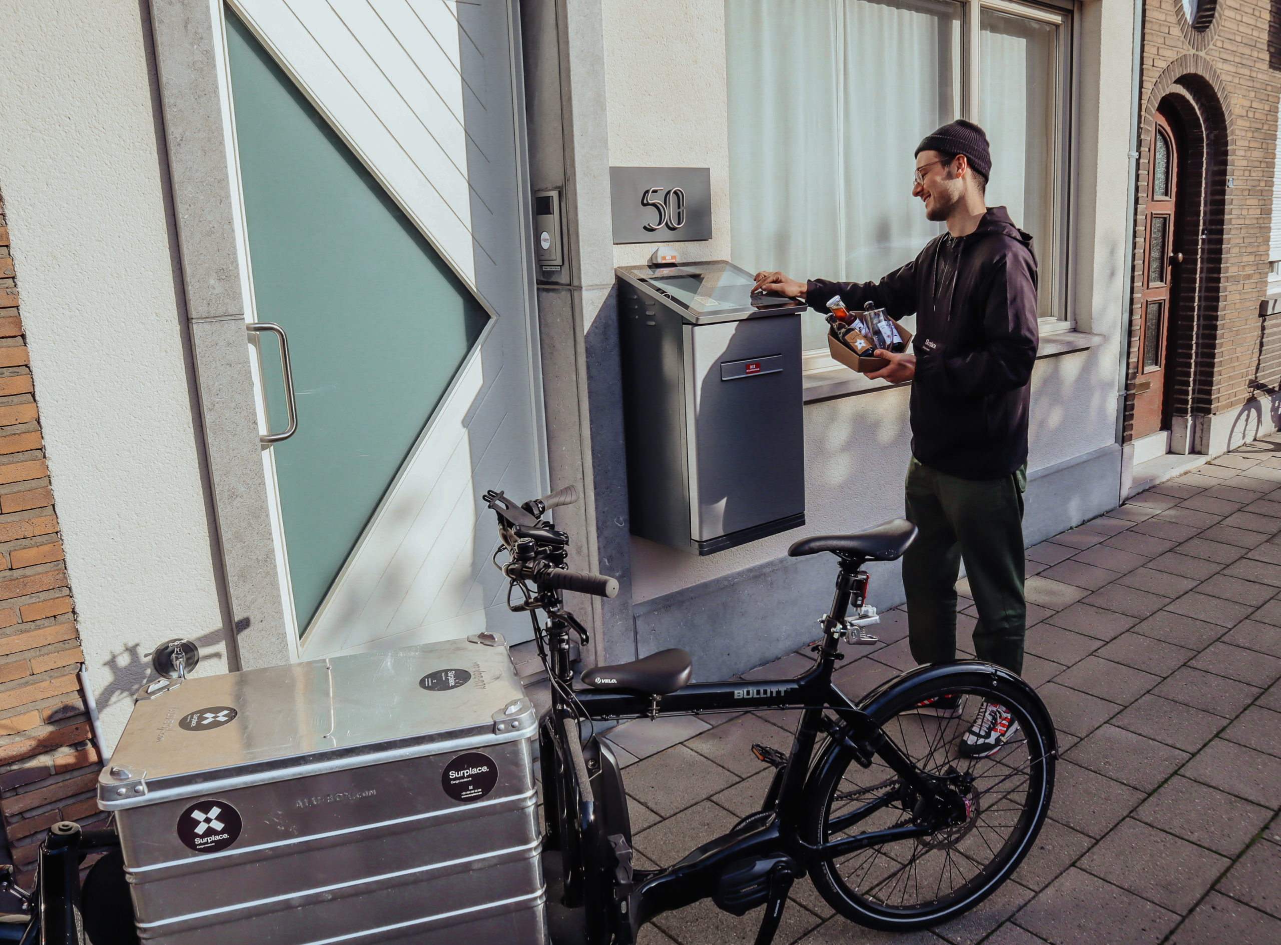 A cycling courier delivering in a ParcelHome
