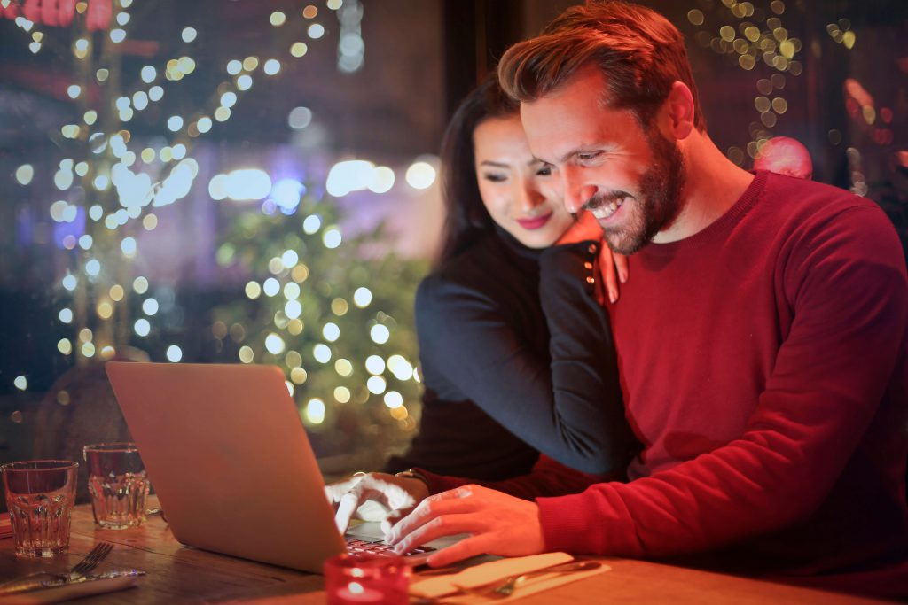 A Couple is Online Shopping for Parcels